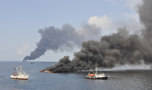 Deepwater Horizon Spill: Pulling oil to a fire boom.